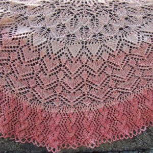 """PT-174 Pasi Shawl LEVEL OF EXPERIENCE: Intermediate  SIZE: 19"""" tall and 50"""" wide YARN: PACA PEDS by The Alpaca Yarn Company, 20% Alpaca, 65% Superwash Wool, 15% Nylon (25g) = 100 yds (6 skein gradient kit)  NEEDLES:  Size US #6 (4.0 mm) 29"""" circular needles NOTIONS:  tapestry needle, ring markers, Size G (4.0 mm) crochet hook GAUGE:  18 sts and 32 rows = 4"""" in stockinette stitch"""